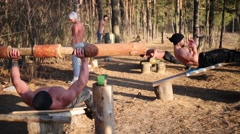 Five men do exercises with improvised equipment for gymnastics Stock Footage