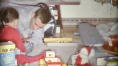 Father And Son Playing With Christmas Gifts Together-1963 Vintage 8mm film Stock Footage