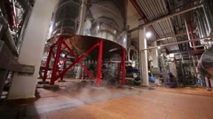 Empty workshop with reservoirs and steam in big brewery Stock Footage