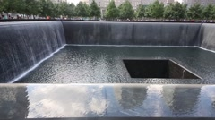 Square waterfall memorial of people killed in terrorist attacks Stock Footage