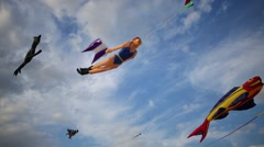 Many soaring bright kites in blue sky at summer sunny day Stock Footage