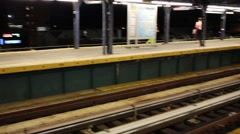 Train arrives in modern subway in New York, United States Arkistovideo