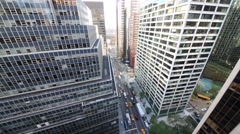 High skyscrapers and small cars on street In New York City, USA. Stock Footage