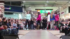 Stock Video Footage of Models young girls walking in circles on the catwalk showing a new line