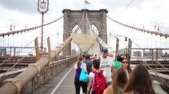 Tourists on Brooklyn Bridge - one of oldest suspension bridges in US Stock Footage