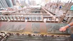 Relief showing construction of  Brooklyn Bridge. Stock Footage