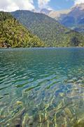 Lake Ritsa in mountains in Abkhazia. - stock photo