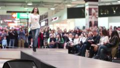 Models one beautiful girl walks on the catwalk, her photograph, viewers watch Stock Footage