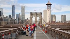 Many tourists on Brooklyn Bridge - one of oldest suspension bridges in US Stock Footage