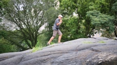 Boy walk on rocks in Central park (model with release). Stock Footage