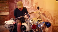 Boy on motor cycle (model with release) in Museum of mafia Stock Footage