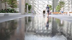 Boy goes on water on floor  in National Portrait Gallery Stock Footage