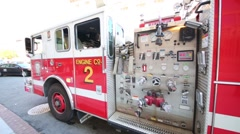 Red fire truck. In US, number of firefighters is 1148850 people Stock Footage