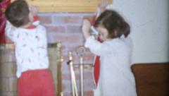 Excited Children Hang Christmas Stockings-1963 Vintage 8mm film - stock footage