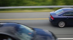 Fast motion in car on road with other cars at summer day - stock footage