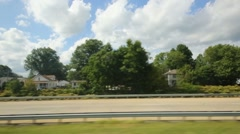 Speedy motion of cars on high way near settlement of cottages Stock Footage