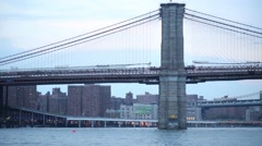 Cars and people move on Brooklyn bridge in New York. Stock Footage
