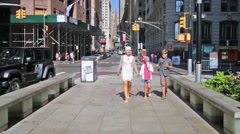 Mother with two children walk at street (models with releases). Stock Footage
