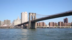 Brooklyn bridge and skyscrapers of New York city. View from ship. - stock footage