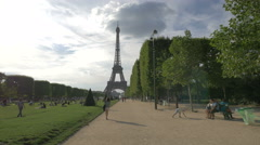 Young woman walking on Avenue Anatole France, heading to Eiffel Tower, Paris Stock Footage