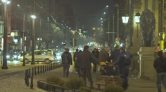 fast-paced city with tram ,cars and people on the boulevard - stock footage