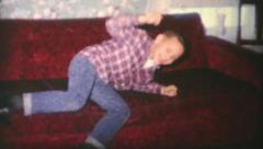 Family Members Pose On Sofa-1970 Vintage 8mm film Stock Footage