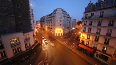 Street with cars at night in residential district in Paris, France Stock Footage