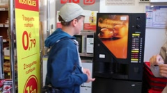 Mother with son (models with releases) stand near coffee machine Stock Footage