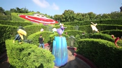 People in garden in Fantasyland of Disneyland in Paris, France. Stock Footage