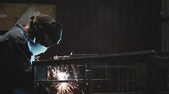 Man welding on a foundry factory, construct - stock footage