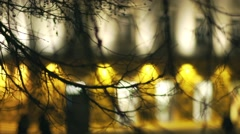 Silhouettes of tree branches with background spectacular lights of building Stock Footage
