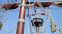 Tackle and black flag of old pirate ship in summer day Stock Footage
