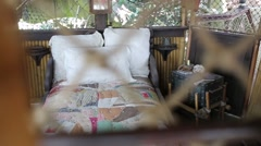 Beautiful bedroom with chest in tropical hut at summer Stock Footage