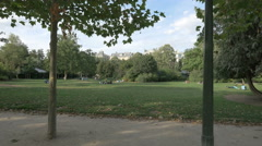 Lying on grass at Champ de Mars, on a sunny day in Paris Stock Footage