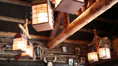 Interior: ceiling of wooden indian hut with lamps and logs Stock Footage