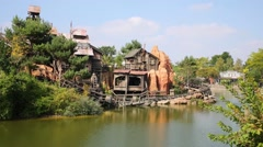 Water, old houses and railway in Frontierland of Disneyland Stock Footage