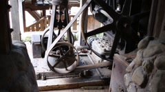 Mechanism with spinning rusty wheels outdoor at summer day Stock Footage