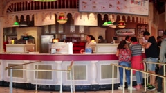 People in cafe (boy with model release) in Disneyland Stock Footage