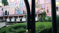 People ride on train near fountain in Disneyland in Paris, France. Stock Footage
