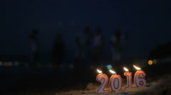 Lit candles as symbol of New Year 2016 Stock Footage