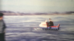 People Racing Snowmobiles On The Lake-1970 Vintage 8mm film Stock Footage