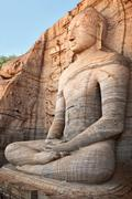 Stock Photo of Ancient sitting Buddha image, Gal Vihara, Polonnaruwa, Sri Lanka