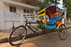Empty bicycle rickshaw in street. Pondicherry, South India Stock Photos