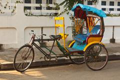Stock Photo of Empty bicycle rickshaw in street. Pondicherry, South India