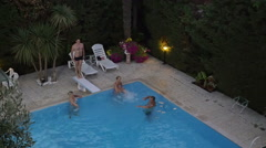 Family in the swimming pool on resort - stock footage
