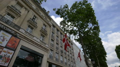 Two Danish flags on La Maison du Danemark, on Avenue des Champs-Elysees, Paris Stock Footage