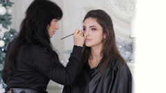 Professional make-up master doing visage - stock footage