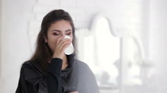 Beautiful model drinking from glass Stock Footage