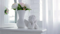 Decorative Cupid and vase with flowers - stock footage