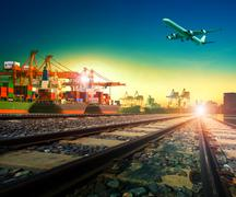 Railway transport in import export shipping port and cargo plane logistic fly Stock Photos